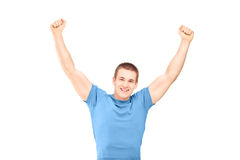 A handsome guy gesturing happiness Stock Images