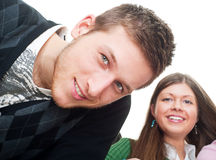 Handsome guy and girl looking at camera Royalty Free Stock Photography