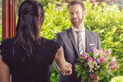 Handsome Guy Gives Fresh Flowers to his Girlfriend Royalty Free Stock Images