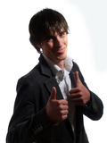 Handsome guy is giving two thumbs up Royalty Free Stock Photo