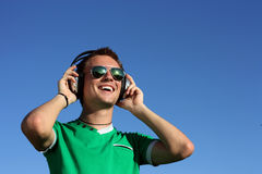 Handsome guy with the glasses listens to music Stock Photos