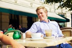 Handsome Guy Hanging Out in a Street Cafe Stock Photography
