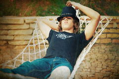 Handsome guy in a hat and jeans. Stock Image