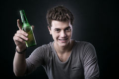 Handsome guy having a beer Royalty Free Stock Photos