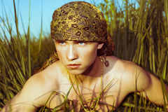 Handsome guy in headscarf. Looking into the distance Royalty Free Stock Photo