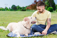 Handsome guy with his dog Royalty Free Stock Image