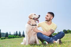 Handsome guy with his dog Royalty Free Stock Photo