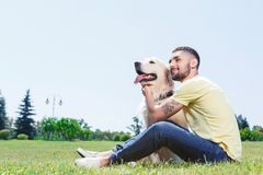 Handsome guy with his dog Stock Photo