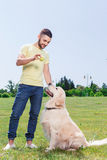 Handsome guy with his dog Stock Photos