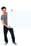 Handsome guy holding blank ad board Royalty Free Stock Photo