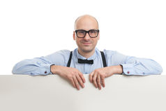 Handsome guy holding a blank billboard Stock Photography