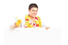 Handsome guy holding a cocktail and panel Royalty Free Stock Photography