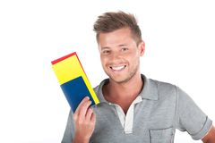 Handsome guy holding passport and smiling. Royalty Free Stock Photography