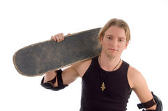 Handsome guy holding skateboard on his shoulder. On an isolated white background Royalty Free Stock Image
