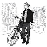 A handsome guy in jeans and a jacket with a vintage bicycle on the city street. Hipster. Vector illustration. Stock Photos