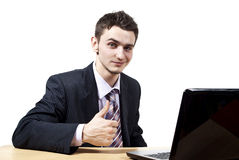Handsome guy with a laptop Royalty Free Stock Image