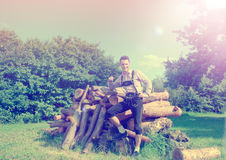 Handsome guy in Lederhosen posing outside Royalty Free Stock Photos