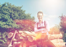 Handsome guy in Lederhosen posing outside Royalty Free Stock Image