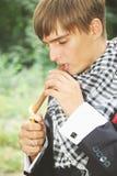 Handsome guy lights a cigar Stock Images