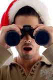 Handsome guy looking into binoculars and surprised Stock Photo