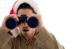 Handsome guy looking into binoculars and surprised Stock Photos