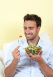 Handsome guy loves healthy food Royalty Free Stock Photography