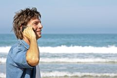 Handsome guy making a phone call stock images