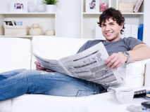 Handsome guy with newspaper Royalty Free Stock Image