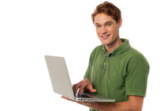 Handsome guy operating laptop Royalty Free Stock Photo