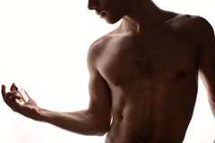 Handsome guy with perfume Stock Photography