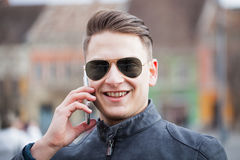 Handsome guy on the phone Stock Photography