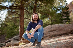Handsome guy in pine forest. Handsome guy in nature, camping or hiking Royalty Free Stock Images