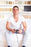Handsome guy playing video game Royalty Free Stock Images