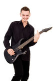 Handsome guy plays the electric guitar Royalty Free Stock Photos