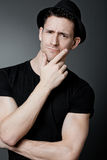 Handsome guy posing in black t-shirt. Stock Images