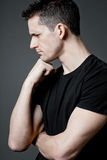 Handsome guy posing in black t-shirt. Royalty Free Stock Image