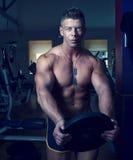 Handsome guy posing. Bodybuilder Stock Image
