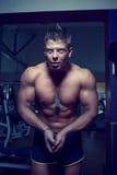 Handsome guy posing. Bodybuilder Royalty Free Stock Image