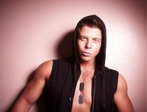 Handsome guy posing in hood. Bodybuilder Royalty Free Stock Photo