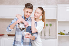 Handsome guy pouring out coffee for girl Royalty Free Stock Photography