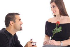 Handsome guy proposing with diamond Royalty Free Stock Images
