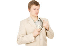 A handsome guy puts the money in his pocket and looks around Stock Image