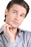 Handsome guy puzzled Stock Photography