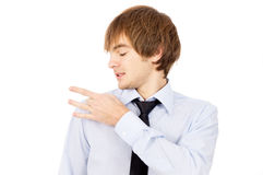 A handsome guy removes dandruff, dressed in a shirt and tie Stock Images