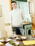 Handsome guy serving festive table Royalty Free Stock Image