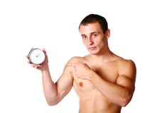 Handsome guy shirtless with clock Royalty Free Stock Image