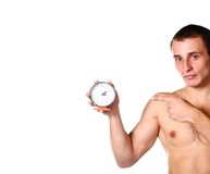 Handsome guy shirtless with clock Stock Photography