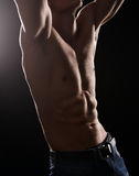 Handsome guy showing his abs Royalty Free Stock Photography
