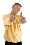 Handsome guy showing  thumbs up with both hands Stock Image