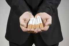 Handsome guy shows cigarettes Royalty Free Stock Photography